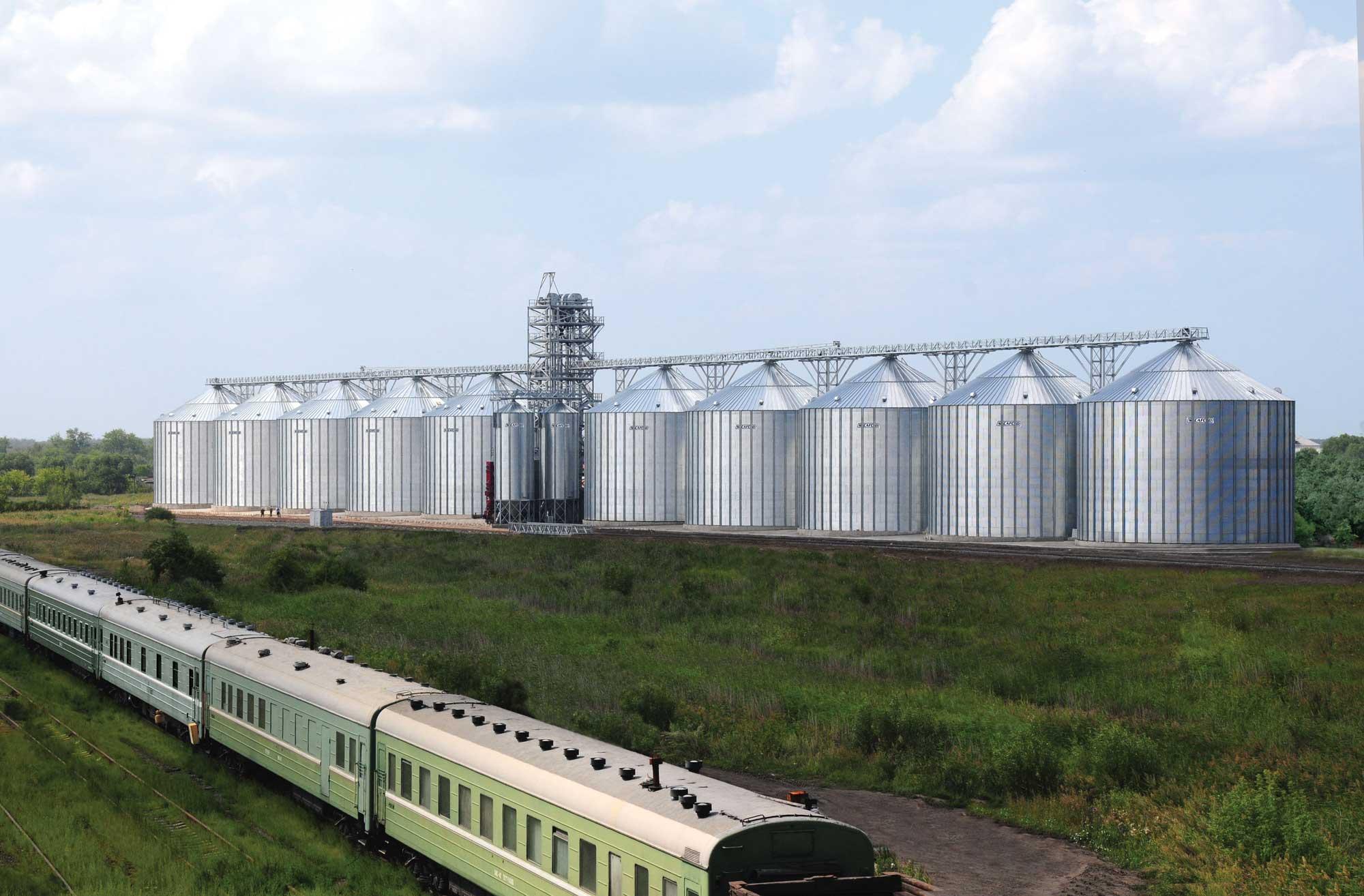 SCAFCO grain bins next to a train passing